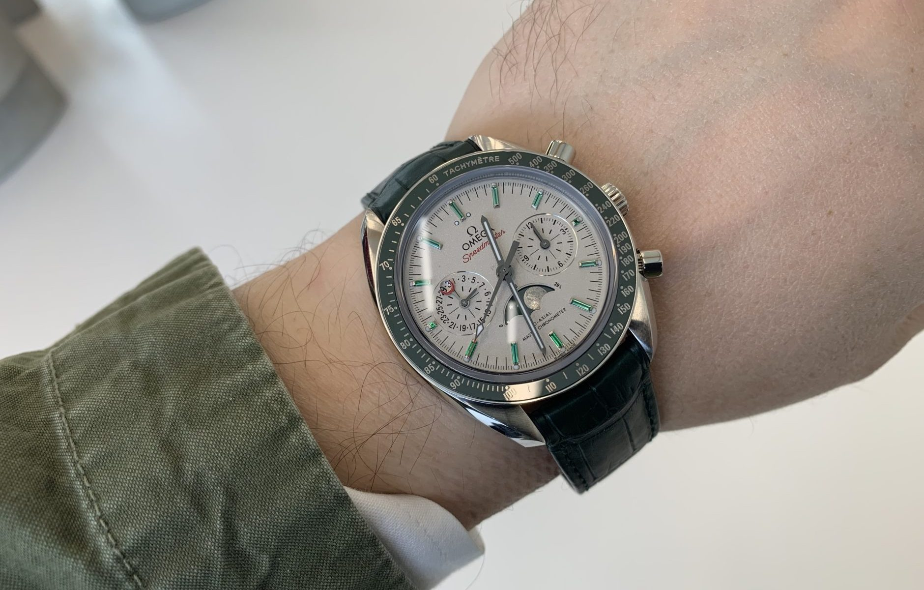 The silvery dials fake watches have moon phases.