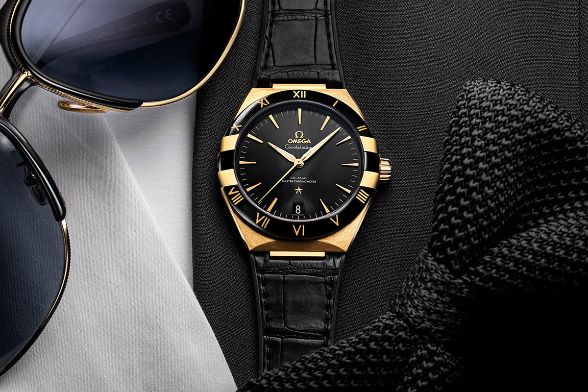 The gold hands and hour markers are contrasted to the black dial of fake Omega.