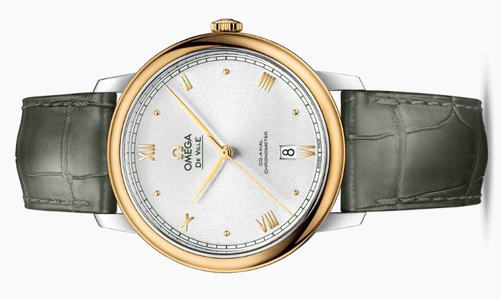 The 18k gold bezel fake watch has a green strap.
