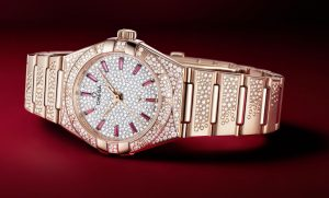 The diamond-paved dial fake watch has ruby hour marks.