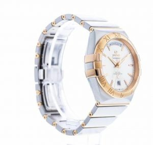 The silvery dial fake watch is made from polished 18k red gold and stainless steel.